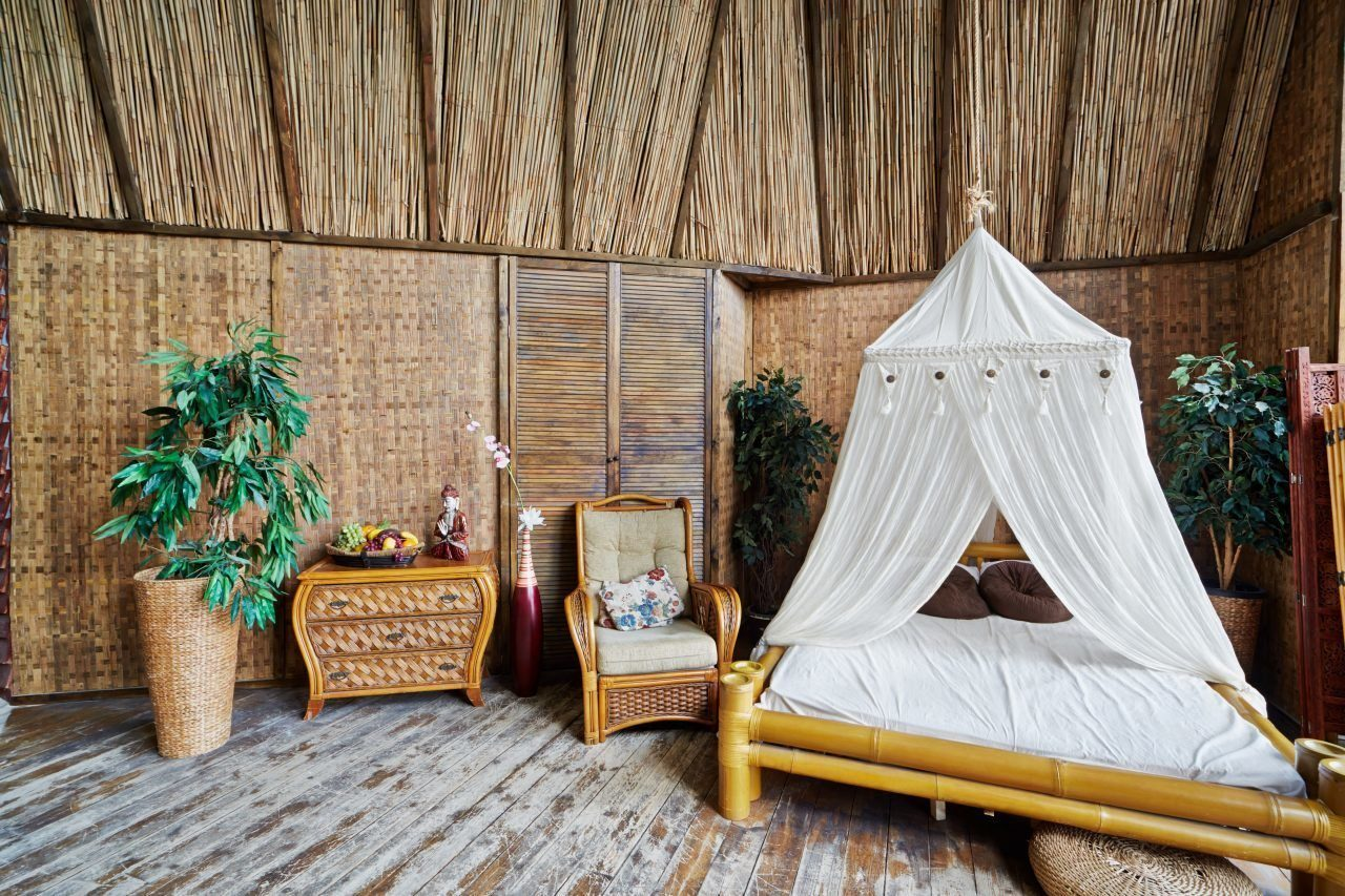 Interior of house made of bamboo with bamboo bed